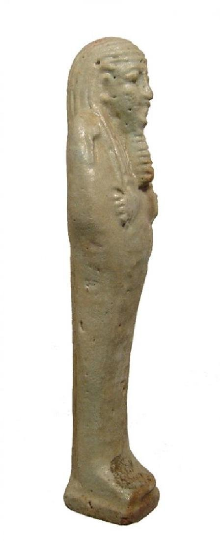 An Egyptian pale green faience ushabti, Late Period - 2