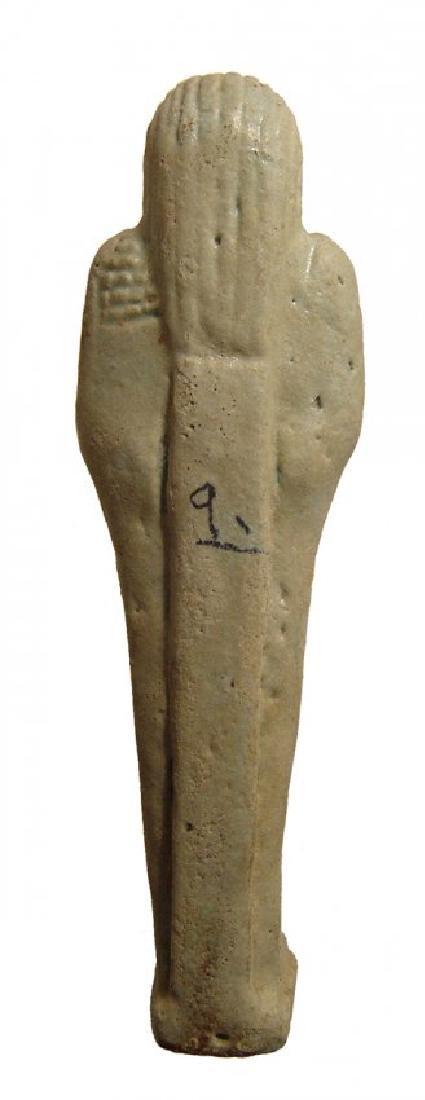 An Egyptian pale green faience ushabti, Late Period - 3