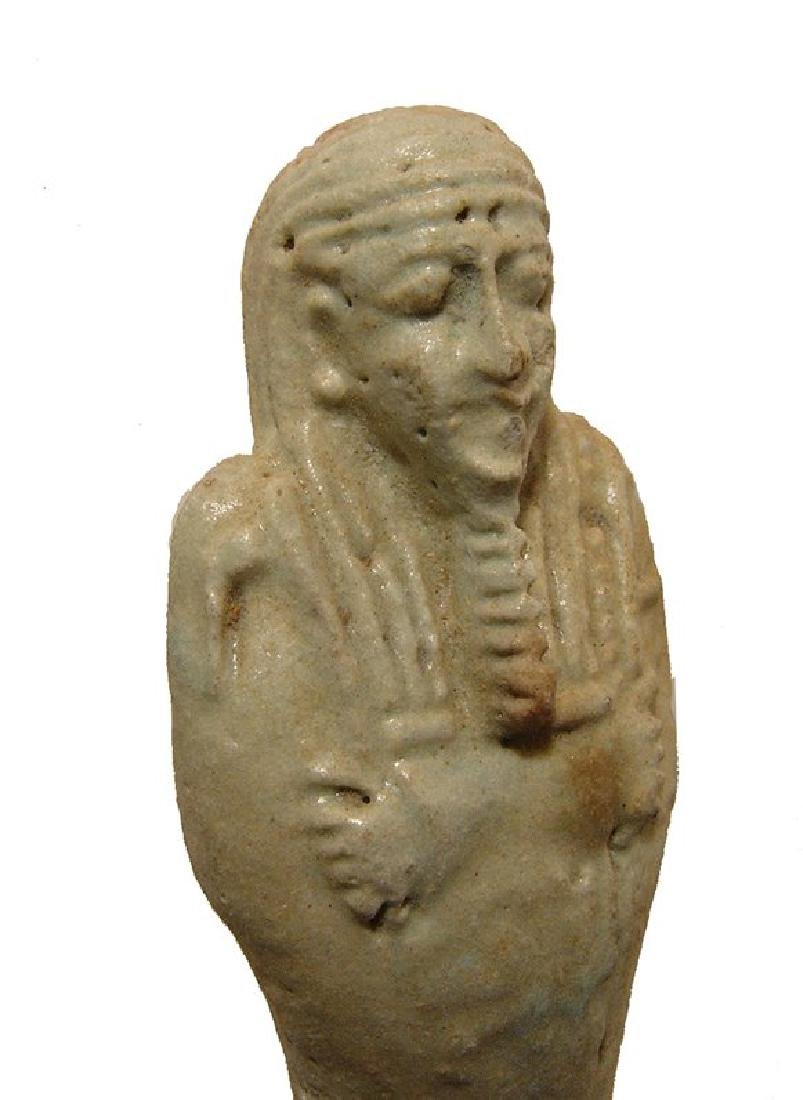 An Egyptian pale green faience ushabti, Late Period - 4