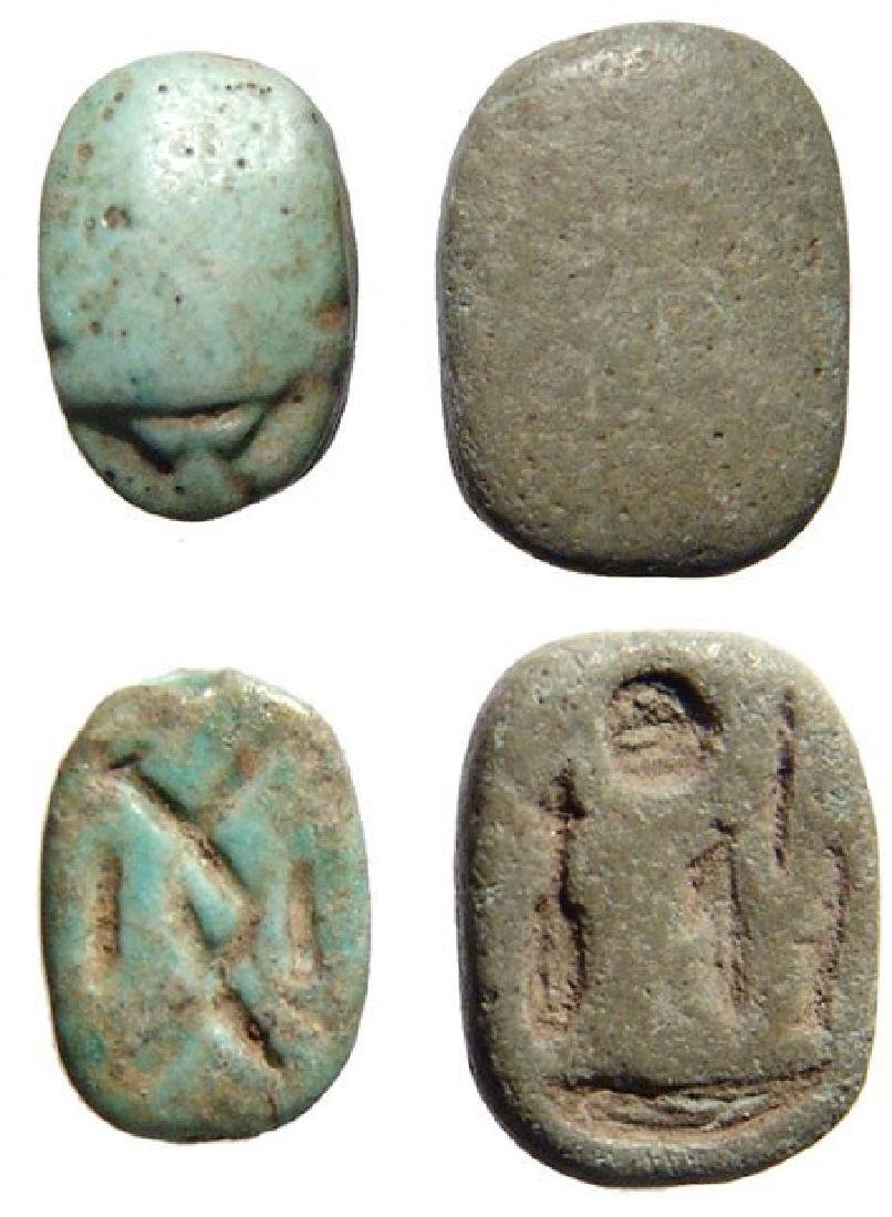 A pair of Egyptian New Kingdom faience scarabs