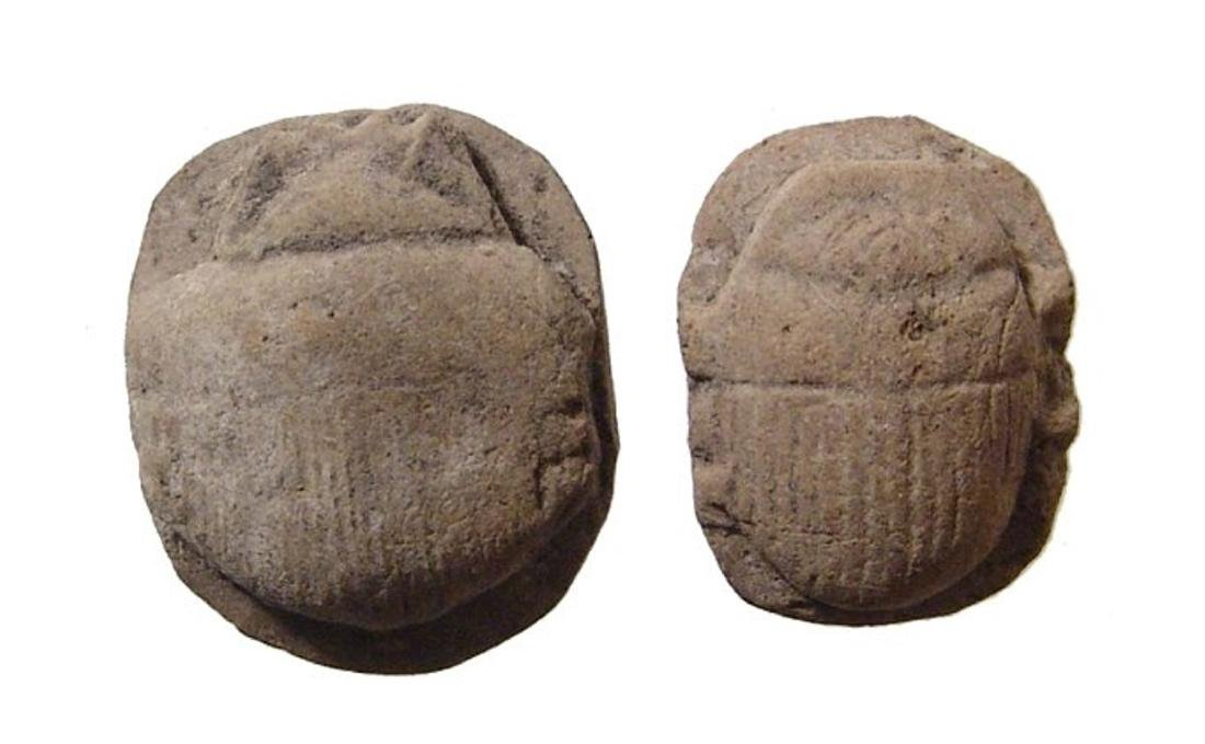 A pair of Egyptian stone scarabs, Late Period