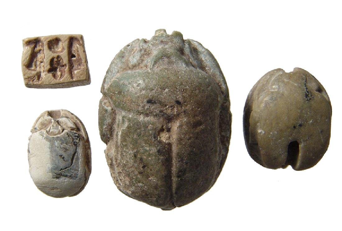 A lot of 3 Egyptian scarabs and a plaque