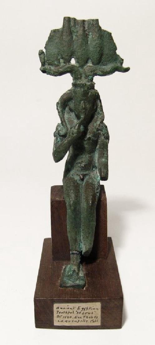 A nice large Egyptian bronze figure depicted