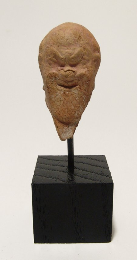 A nice terracotta head wearing and actor's mask