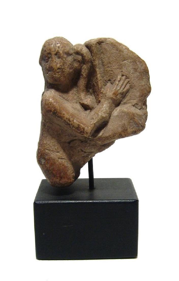 An Egyptian limestone ithyphallic Harpokrates