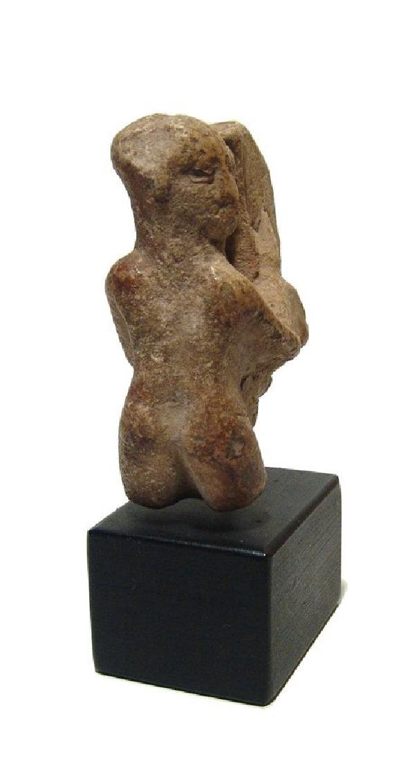 An Egyptian limestone ithyphallic Harpokrates - 2