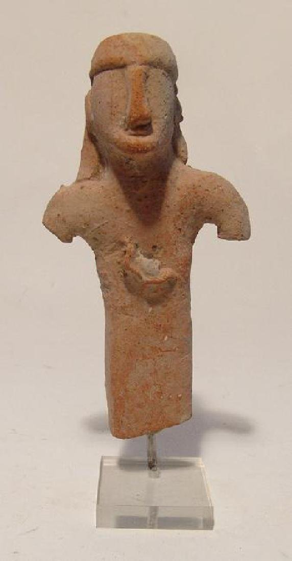 A Cypriot terracotta figure of a young man