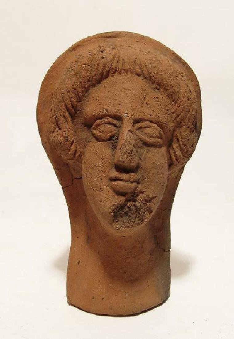 A nicely detailed Etruscan terracotta head of woman