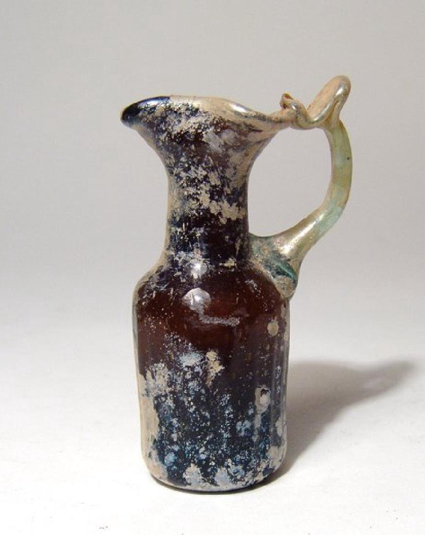 A beautiful Roman amber glass pitcher