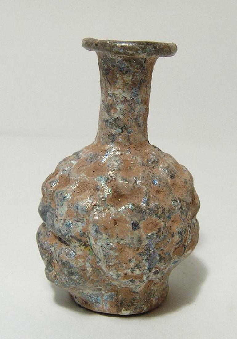 A Roman glass mold-blown janiform head flask - 2