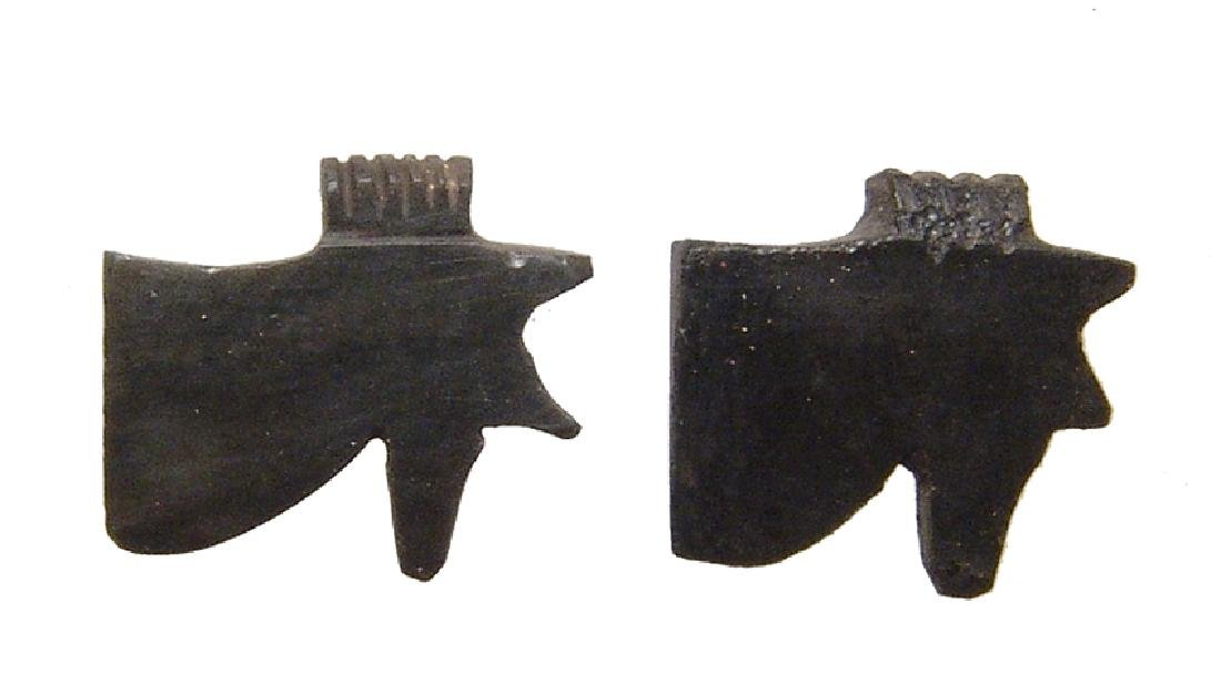 A pair of Egyptian obsidian Eye of Horus amulets
