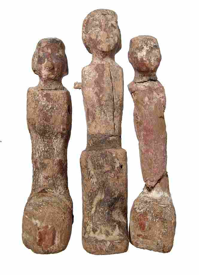 A group of 3 Egyptian wood figures, Middle Kingdom
