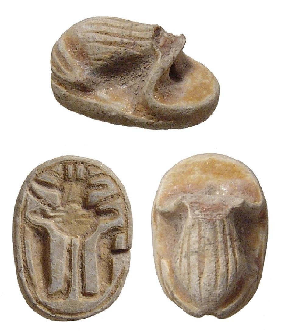An Egyptian faience scaraboid in form of frog