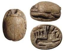 An Egyptian steatite scarab depicting Anubis