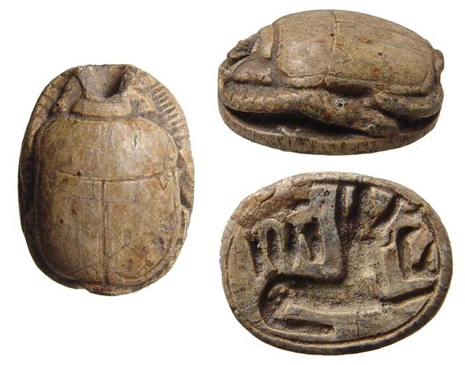 An Egyptian steatite scarab depicting Anubis