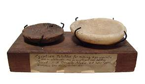 Pair of Egyptian Old Kingdom cosmetic mixing palettes