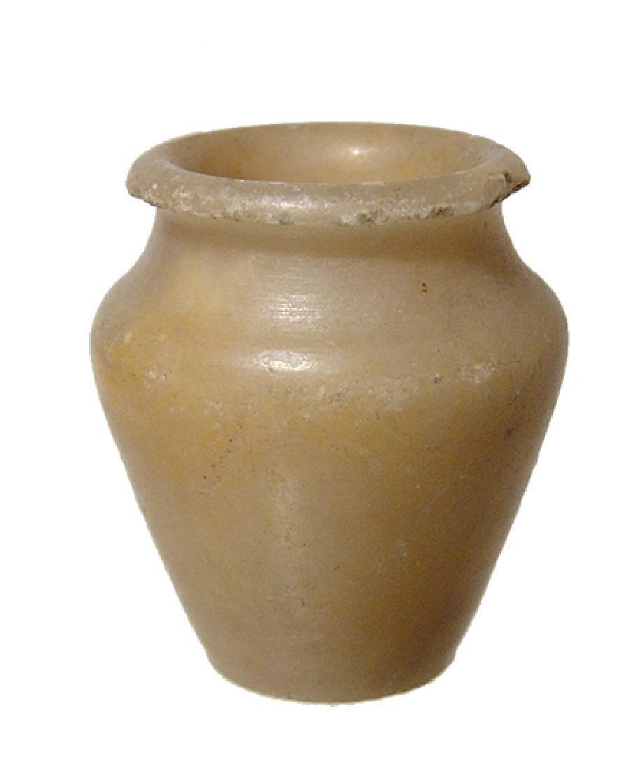 An Egyptian alabaster kohl jar, Middle Kingdom