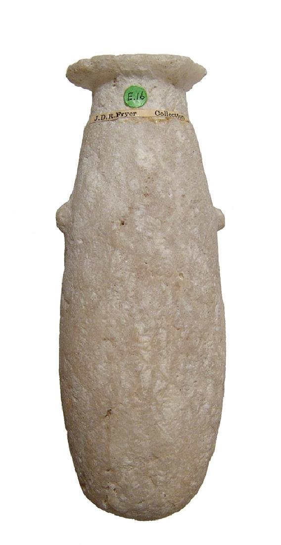 An Egyptian cylindrical stone carved alabastron