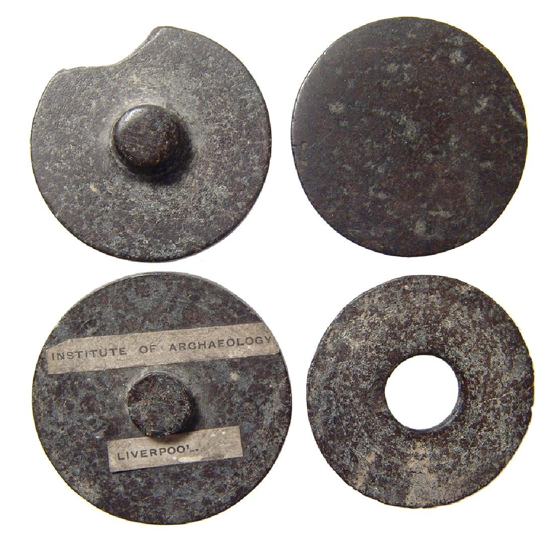 A collection of 4 Egyptian stone cosmetic vessel lids