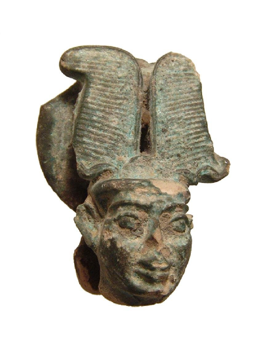 A large Egyptian faience head from a figure of Ptah