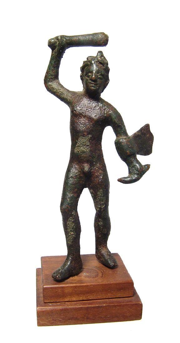An attractive Etruscan bronze figure of Herakles