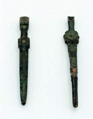 A pair of Roman bronze tweezers