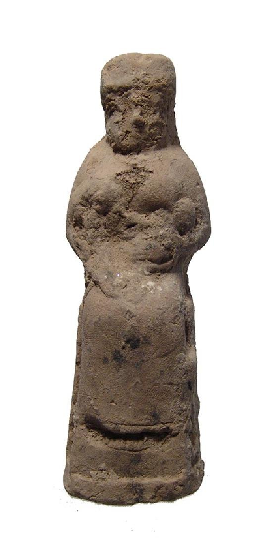 A beautiful Old Babylonian terracotta seated woman