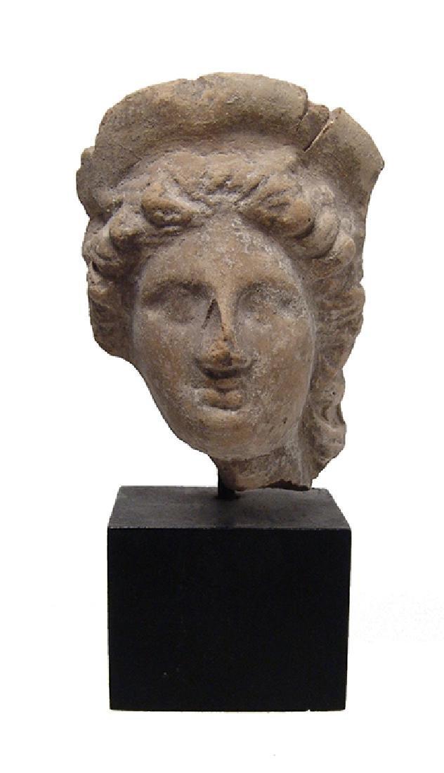 A lovely Greek ceramic head of a woman