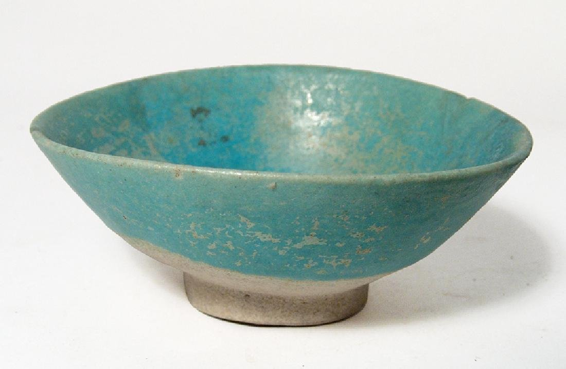 A Persian turquoise glazed bowl