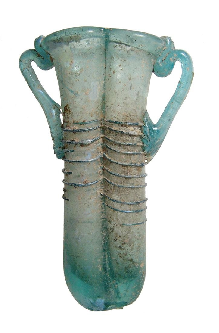 A beautiful Roman blue glass double unguentarium
