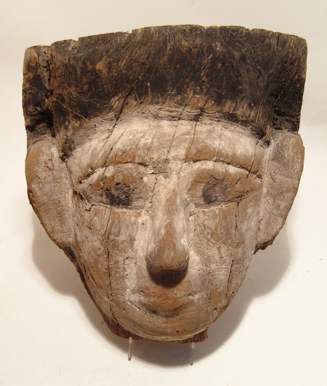 A large Egyptian wooden 'mummy mask', Late Period