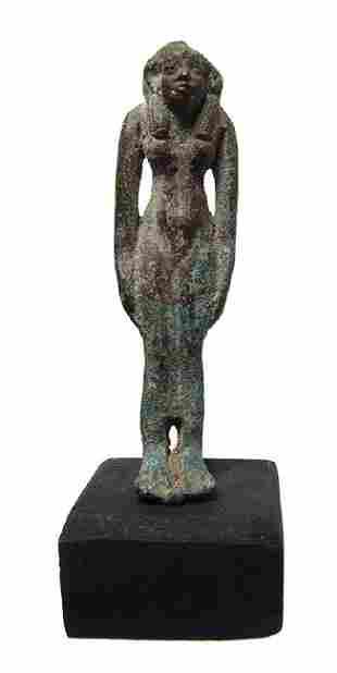An Egyptian bronze figure of a goddess perhaps Hathor