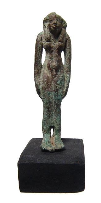An Egyptian bronze figure of a goddess, perhaps Hathor