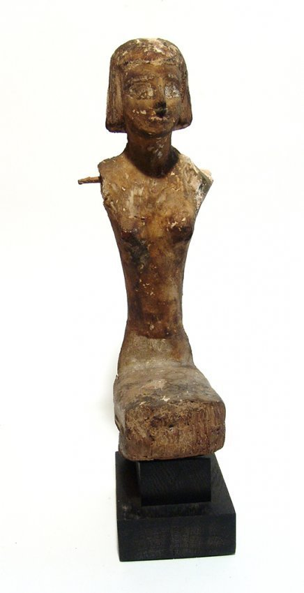 A large Egyptian seated wooden figure, Late Period