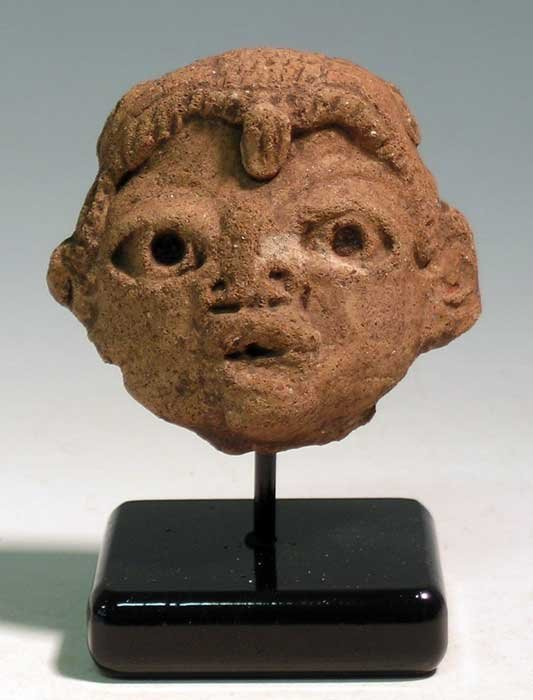 An excellent Olmec head fragment from Guatemala