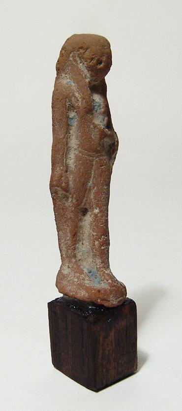 An Egyptian terracotta figure, Late Period - 2