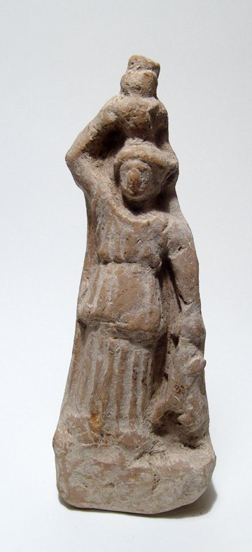 A Roman terracotta figure of a woman with hare and jar