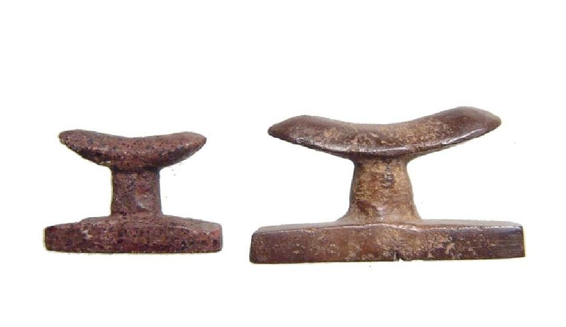 A pair of Egyptian stone headrest amulets, Late Period