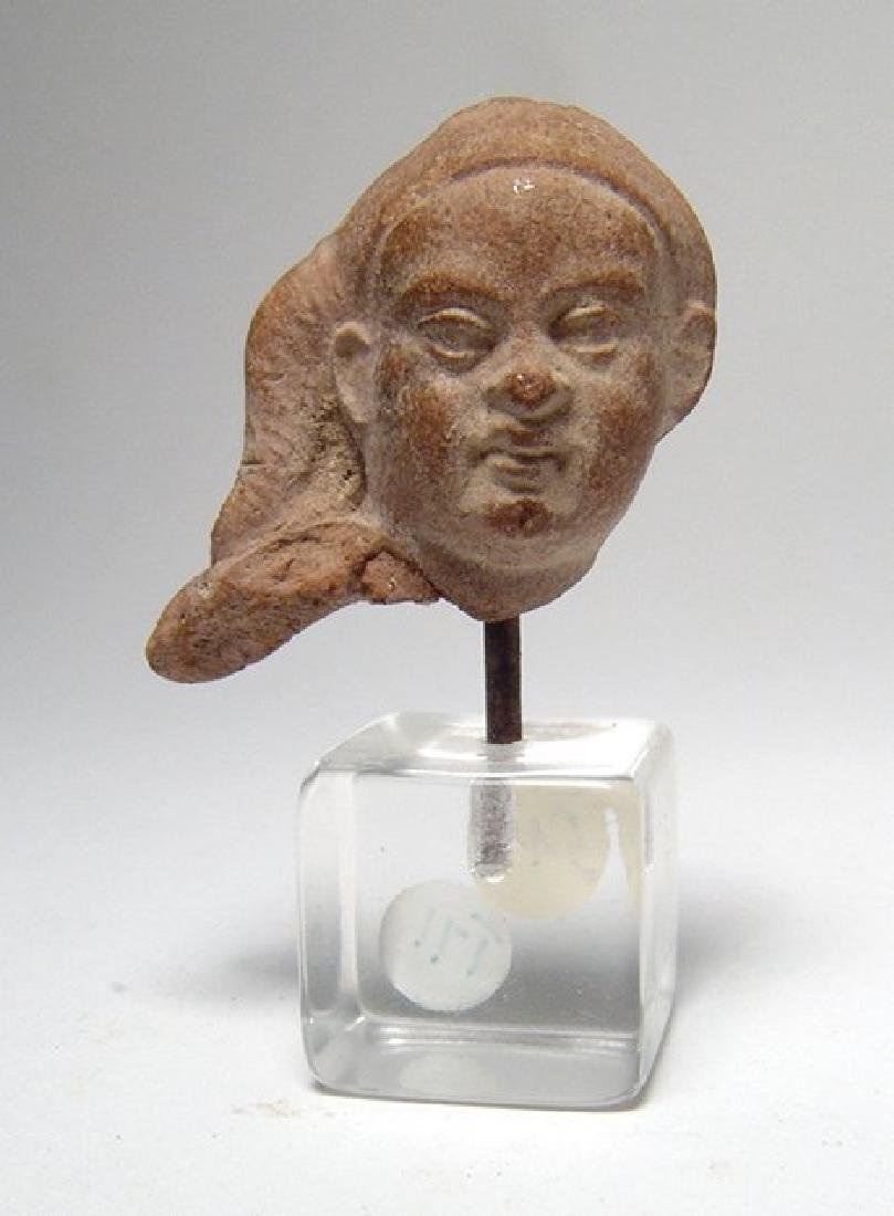 An Egyptian Ptolemaic head of Harpokrates