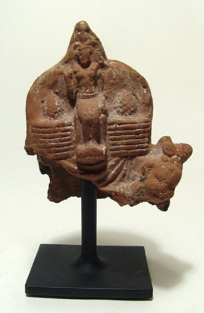 An Egyptian terracotta votive depicting seated pharaoh