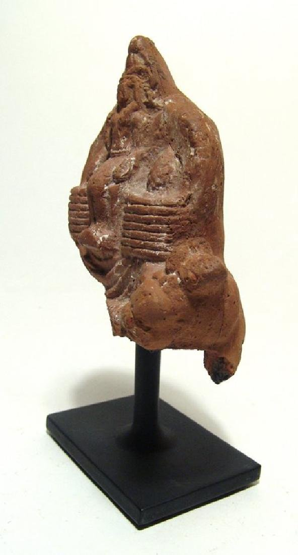 An Egyptian terracotta votive depicting seated pharaoh - 4