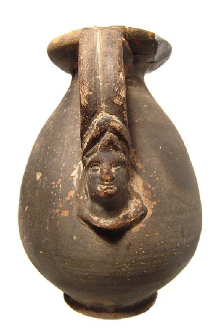 A nice Hellenistic Greek ceramic olpe with female head