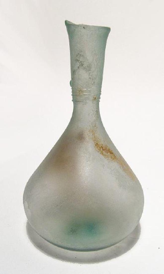 A Roman pale blue glass bottle, Eastern Mediterranean