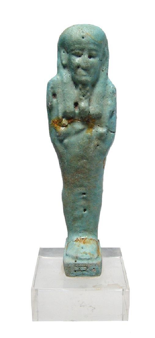 An Egyptian turquoise blue faience ushabti