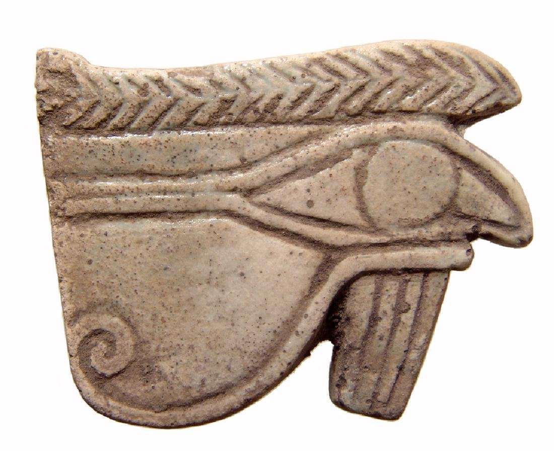 Egyptian faience 'Eye of Horus' amulet, Late Period