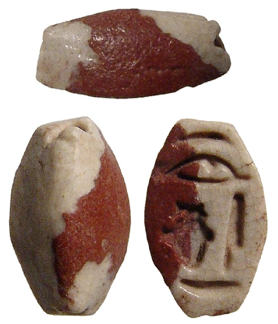 An Egyptian faience scaraboid, Late Period