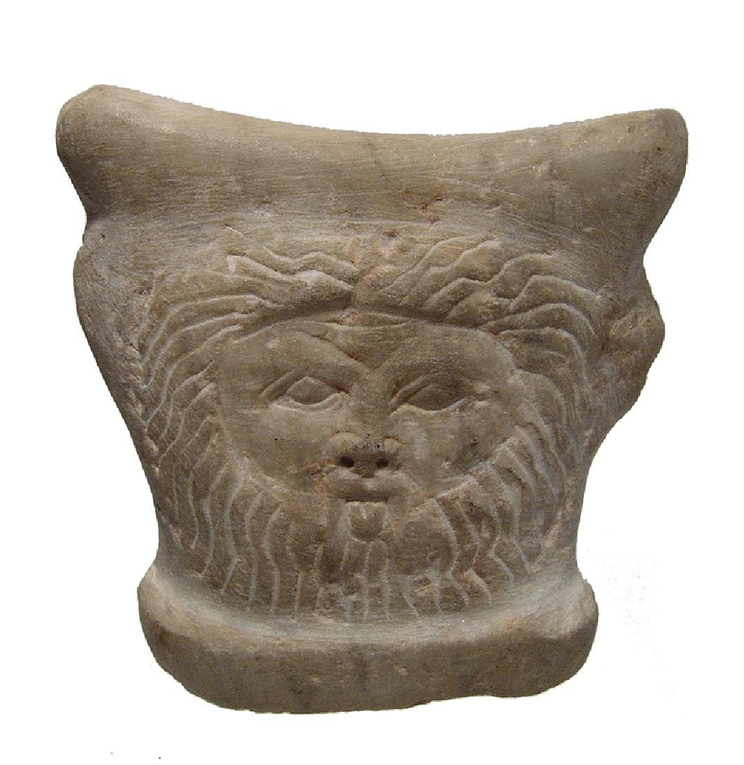 A fantastic Romano-Egyptian marble child's headrest