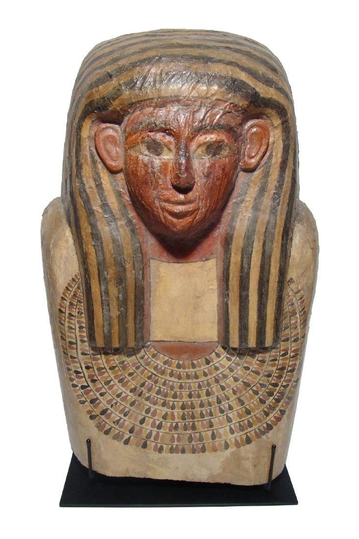 A stunning upper portion of an Egyptian sarcophagus lid