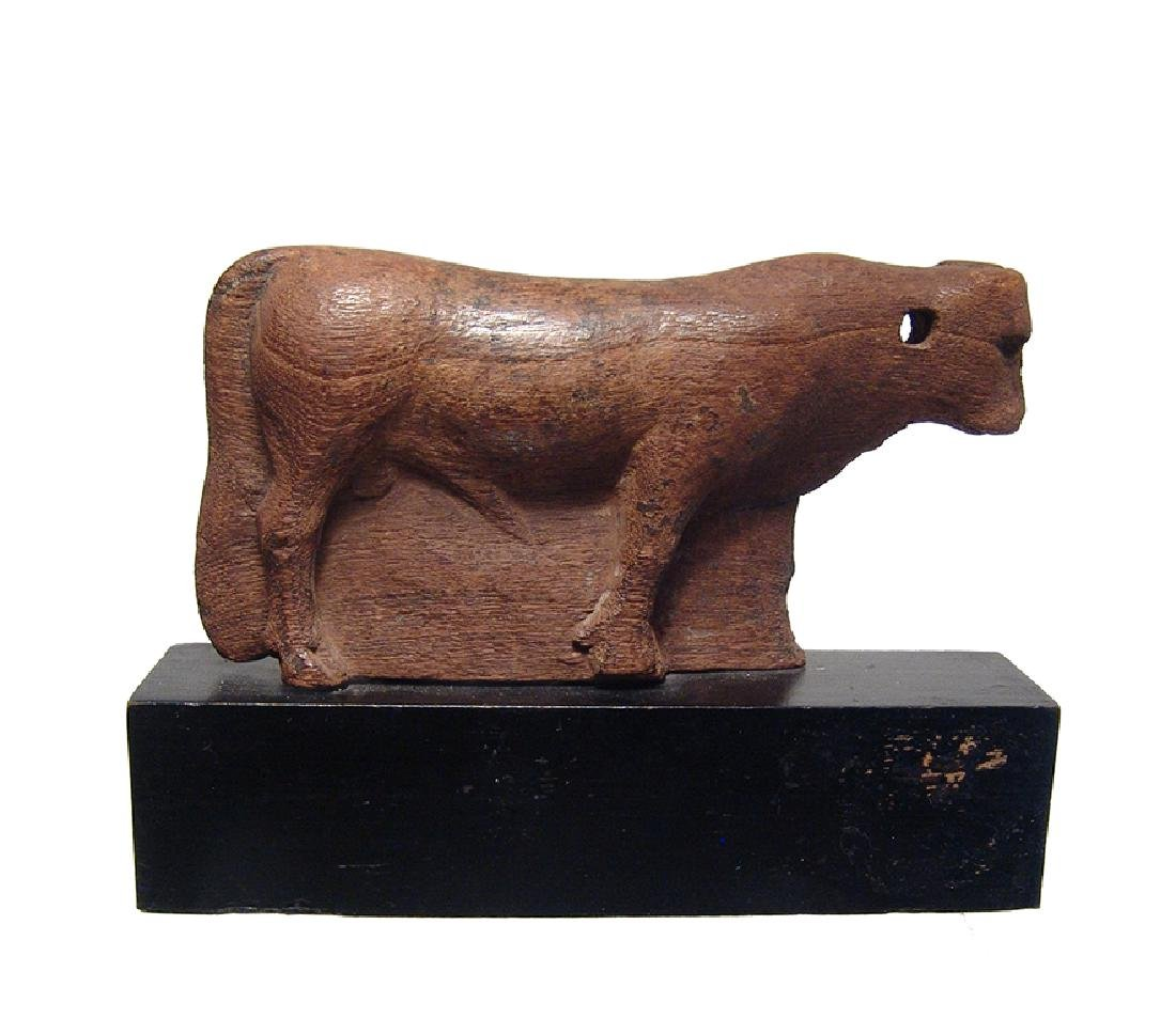 Extremely rare Egyptian wooden depiction of Apis Bull