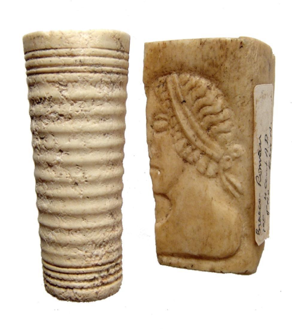 A pair of Romano-Egyptian bone decorative elements